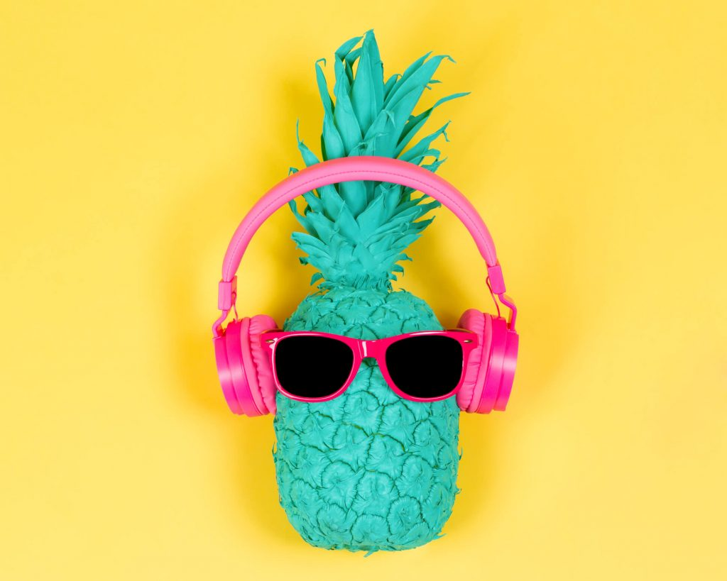 pineapple express strain with a pineapple listening to music with sunglasses n